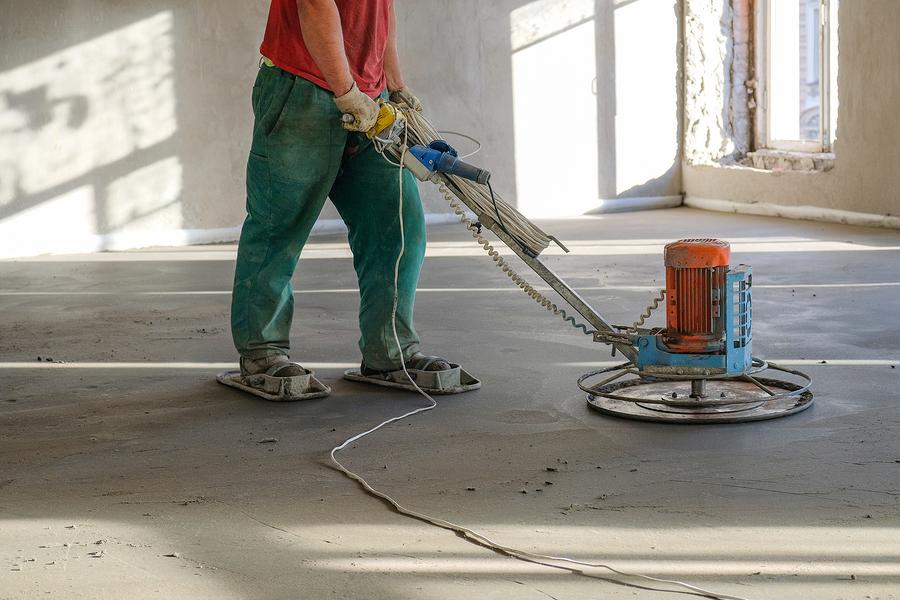 man grinding the floor